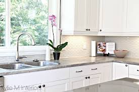 modern kitchen white plain cabinet doors speckled granite