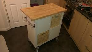 gorgeous ikea kitchen island that using maple wood chopping board