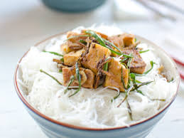 crispy tofu with black pepper ginger and scallions on rice