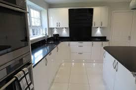 black worktop white cupboards kitchen signature porter white gloss and black quartz worktops