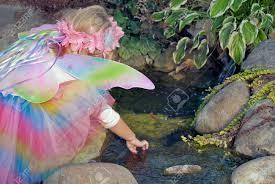 Water Rock Garden by Little Fairy Girl In Rock Garden Playing In Water Stock Photo