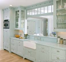 a pale blue victorian kitchen with matching blue countertops a