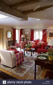 red checked throw on cream armchair in cosy cottage living room