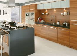 kitchen brown cabinetry with panel appliances also grey island