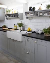 grey paint for kitchen cupboard doors white tiled wall with grey cabinetry kitchen renovation
