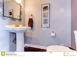 light lavender small bathroom interior with white toilet and