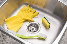 Kitchen Sink Brush Yellow Rubber Gloves Sponge And Brush In A Clean Shiny Kitchen
