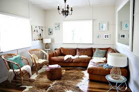 cottage chic living room white sofa half the ceiling orange paint