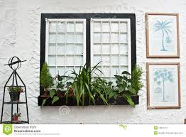 English Tudor Style by Old English Tudor Style Decor White Windows Stock Photography