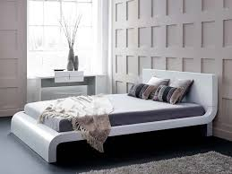 carlotta white modern bed with upholstered headboard the holland