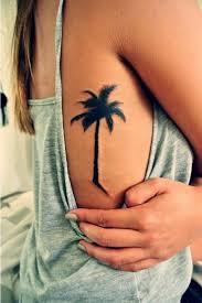 15 palm tree tattoos on side rib