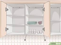 removing kitchen wall cabinets 3 ways to remove kitchen cabinets wikihow