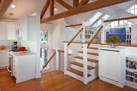 beachside home cape cod open cable railing stair case loft space