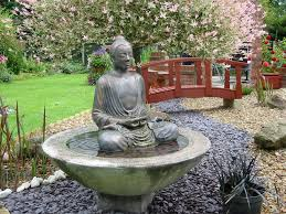 large buddha water feature outdoor garden patio lawn