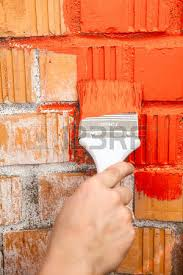 paint brush with green colour on brick wall stock photo picture