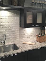 faux brick backsplash in kitchen kitchen backsplashes brown granite countertop white wooden