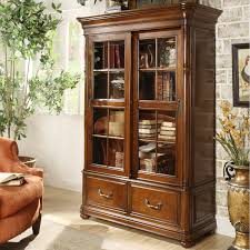 home decoration tall brown bookshelves with glass doors and