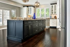 white kitchen cabinets with wood crown molding transitional style between traditional and contemporary