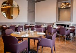 pedrali has fitted out the ore cafe with ester armchairs in dark purple and beige the ester armchairs by the french designer patrick jouin harmonize with the gold used in the former royal residence and which