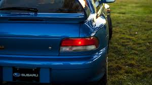 subaru roof spoiler subaru impreza 22b faces off against mitsubishi lancer evolution