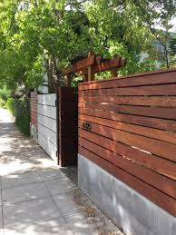 Modern Fence by Wood Metal And Concrete Fence Rmn Pinterest Concrete Fence