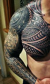 awesome black ink maori ornament on arm and chest