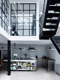 paper house project channels gridded glass atrium through london