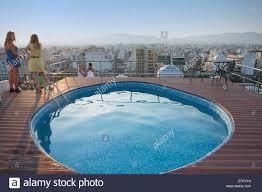 athens greece october 5 people on top of the hotel with a