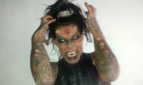 has black eye tattoos and horns implants in his