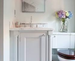 traditional powder room with limestone tile floors pedestal sink