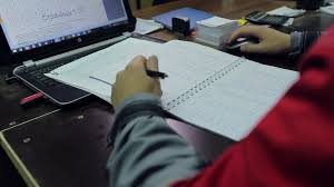 writing concept paper factory worker sitting at the desk and making notes in the manager making a report using laptop and writing in the notebook bureaucracy and paperwork concept stock video footage videoblocks