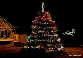 lobster trap tree with the lighthouse in the background picture