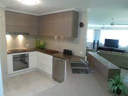 stunning kitchen design featuring waterfall end and feature