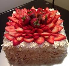rectangular mocha tres leches cake with strawberries tres