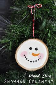 easy ornament craft using a wood slice clumsy crafter