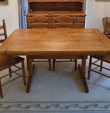 oak trestle dining table oak trestle dining table and four knotty pine chairs ebth