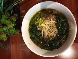 ent cuisine ramen noodles in broth bowl bean sprouts greens succulent food