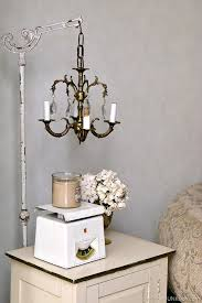 junk chandelier swings from antique lamp stand petticoat junktion