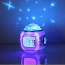 Amazon Com Sky Star Night Light Projector Alarm Clock Home Kitchen