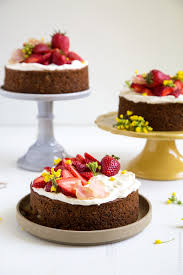 strawberry carrot cake with candied radish and rapini flowers