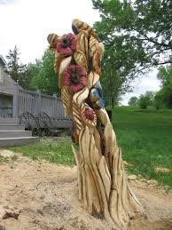 12 best flowers images on pinterest tree art chainsaw carvings