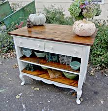 antiques repurposed as kitchen cabinets love the wood mixed with