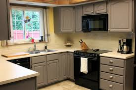 kitchen white appliances black countertop white cabinets charming