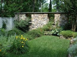 old stone wall landscape traditional with cottage garden fencing