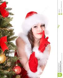 in santa hat making silence gesture royalty free stock