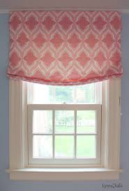 girls nursery with roman shades in christopher farr venecia pink