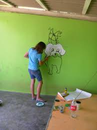 artist yonne latiers painted murals in the puppy kennel yonne in action
