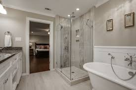 contemporary master bathroom with complex granite u0026 crown molding