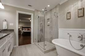contemporary master bathroom with complex granite u0026 crown molding
