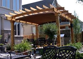 Retractable Shade Pergola by A Retractable Canopy System Custom Fitted Into Arched Rafters
